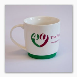 White porcelain mug with detachable green silicon base, specially made to celebrate The Elizabeth Foundation's 40th anniversary